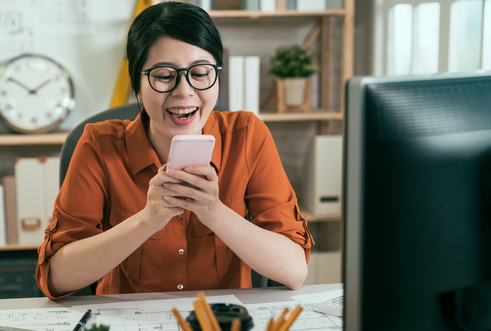 Woman happy about thank you text